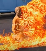 Buddhist monk, protest alleged persecution of Buddhists by the
